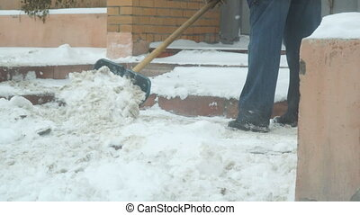 Man cleans snow with shovel - Man cleans snow with a shovel