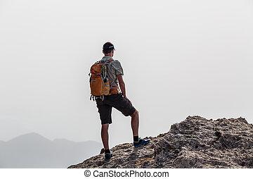 Man climbing hiking inspiration landscape, travel concept