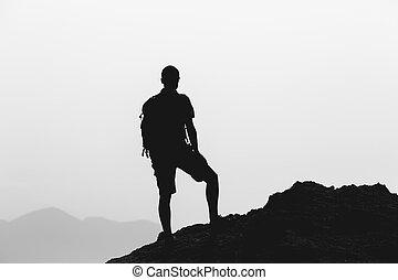 Man climbing hiking inspiration landscape, travel silhouette