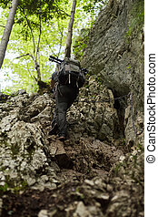Man climbing on a steep hiking trail