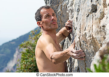 Man climbing on limestone, details
