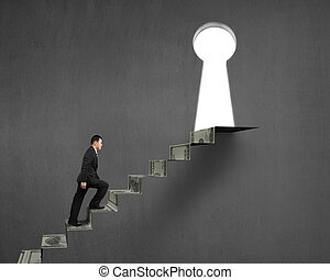 man climbing on money stairs to key hole on concrete wall