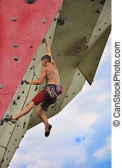 man climbing on wall