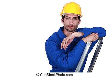 Man climbing step-ladder