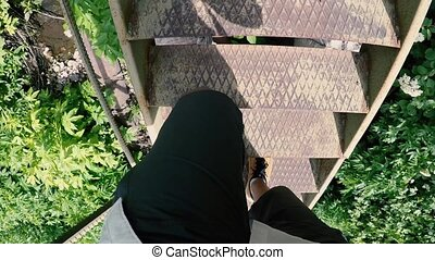 man climbs a long metal staircase, Armenia