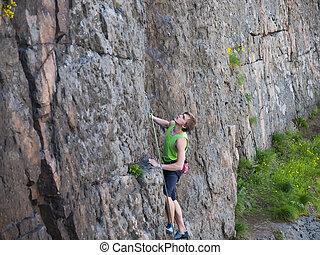 Man climbs up.