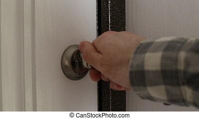 Man close lock of the front door.