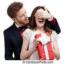 Man closes eyes of his girlfriend, isolated on white