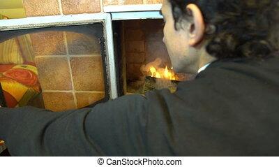 man closing fireplace