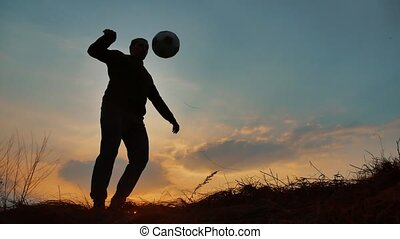 man coins a ball European the football soccer freestyle...