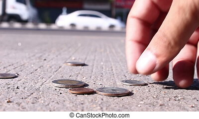 man collect coins on street