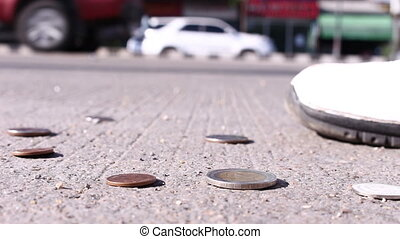 man collect coins on street concrete