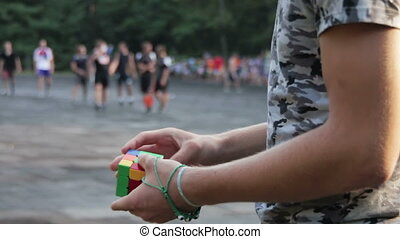 Man Collects in the Hands of the Rubik's Cube - Man quickly ...