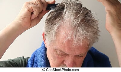 man combing his hair after shower