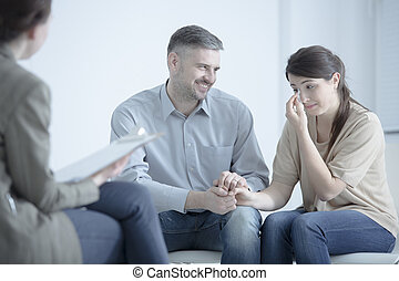 Man comforting crying wife