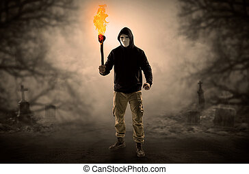 Man coming out from a thicket with burning flambeau