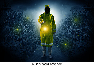 Man coming out from a thicket with lantern