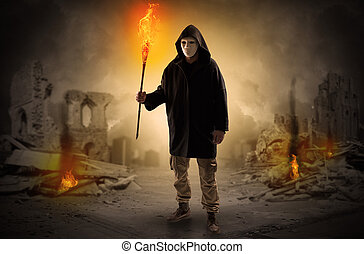 Man coming with burning flambeau at a catastrophe scene concept
