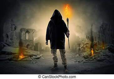 Man coming with burning flambeau at a catastrophe scene ...