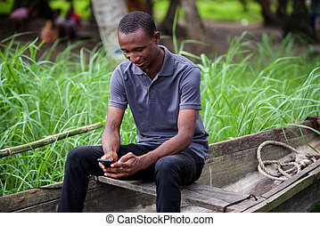 man communicating in a dugout - smiling man sitting on a...