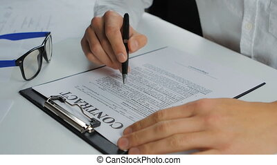 man completes and signs a contract