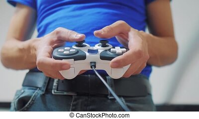 man concept playing gamepad hands video console on tv. Hand...