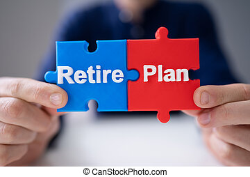 Man Connecting Retirement Plan Piece Into Jigsaw Puzzle