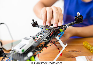 Man connecting the component of the drone