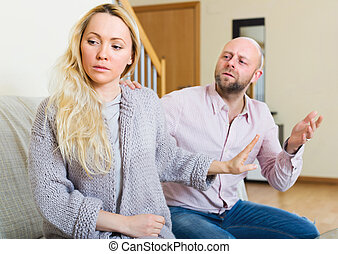 Man consoling the depressed woman