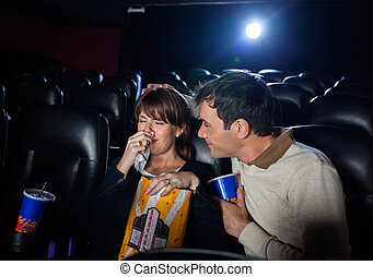 Man Consoling Woman Crying While Watching Movie