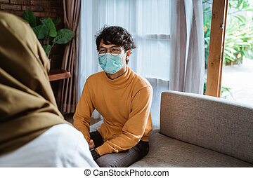 man consulting with his doctor