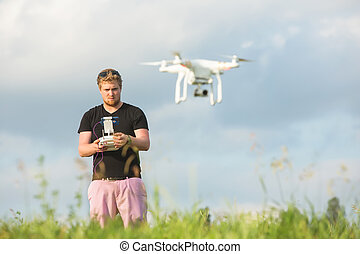 Man Controlling a Drone
