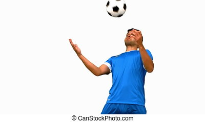 Man controlling a football with his chest on white screen in...
