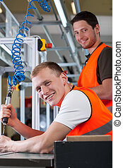 Man controlling assembly process at factory - Man...