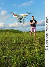 Man Controlling Drone
