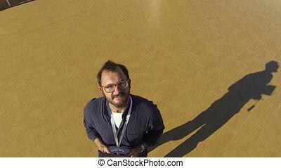Man controlling quadcopter drone - Drone operator...