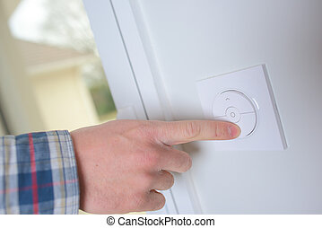 Man controlling the central heating thermostat
