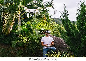 Man controls a quadrocopter