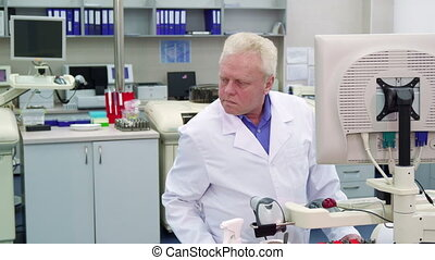 Man controls some process at the laboratory
