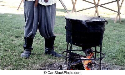 man cooking natural dye - a man digested natural dye