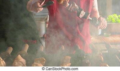 Man cooking shashlik. Juicy meat on a skewer.