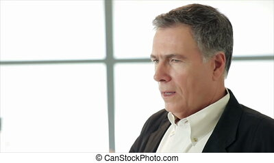 Man Coughing - A mature handsome businessman dealing with a...