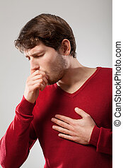 Man coughing - Man with sick lungs holding his chest and...