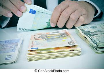 man counting banknotes