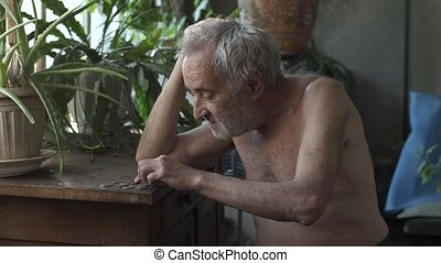 Man counting coins on a table