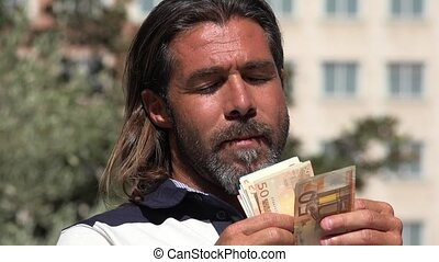 Man Counting Money In Euros