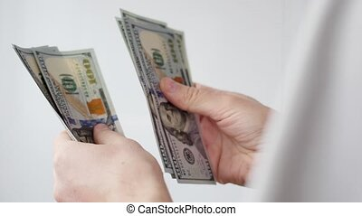 Man counting US dollars. Business, big money of success concept
