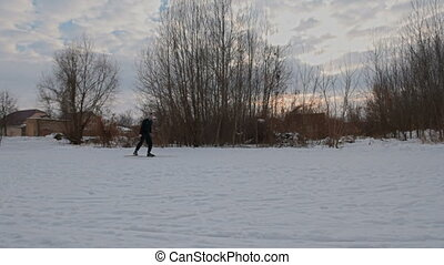 Man cross-country skier over ridge. - Man cross-country...
