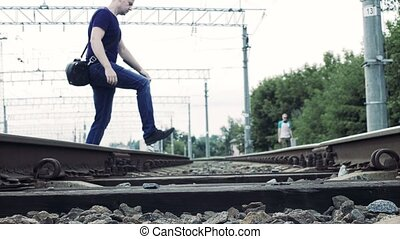 man crosses the railroad in the wrong place, life...