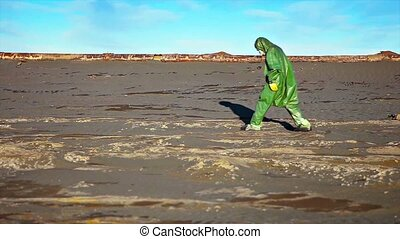 Man Crosses Toxic Waste Site in Chemical Protective Gear -...